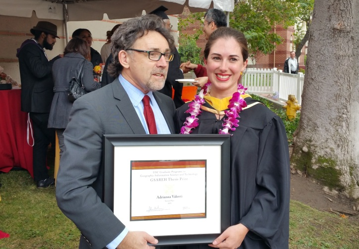Adrianna receiving award from Dr. John Wilson of USC